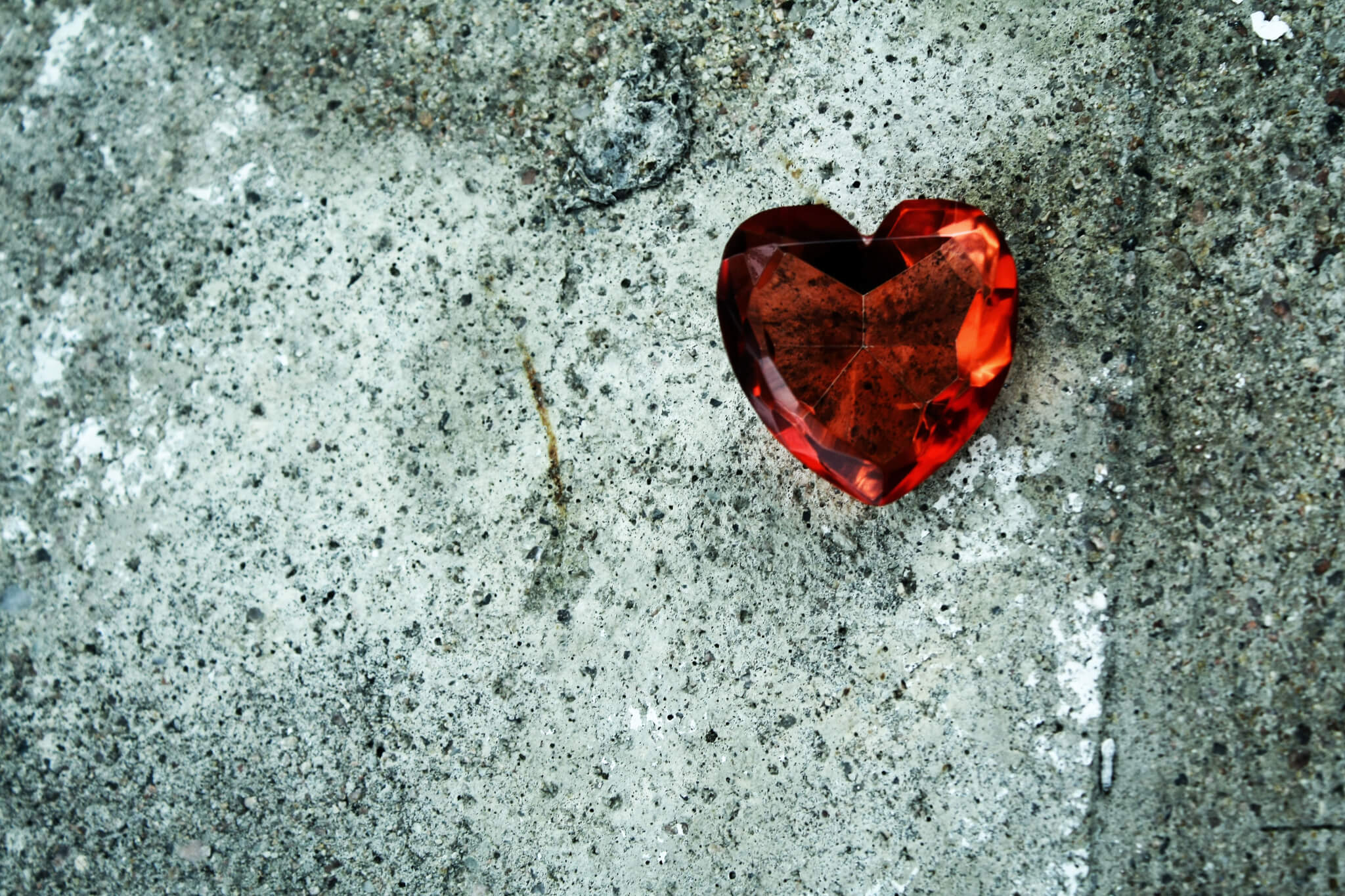Jewel heart on stone background